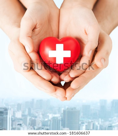 family health, charity and medicine concept - male and female hands holding red heart with cross sign #181606637