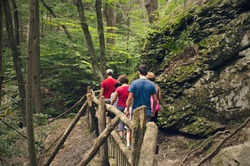 Family hiking in Bushkill Falls, Pennsylvania