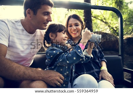 Family Holiday Vacation Park Ride Tourist #559364959