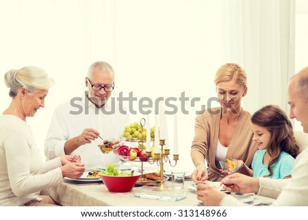 family, holidays, thanksgiving, thanksgiving, generation and people concept - smiling family having dinner at home