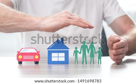 Family, house and car protected by hands - Concept of life, home and auto insurance #1491698783