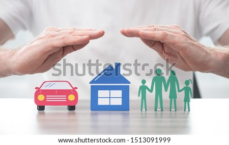 Family, house and car protected by hands - Concept of life, home and auto insurance