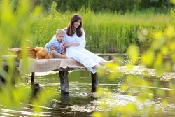 Family idyll mother with her son against the backdrop of beautiful nature outdoors