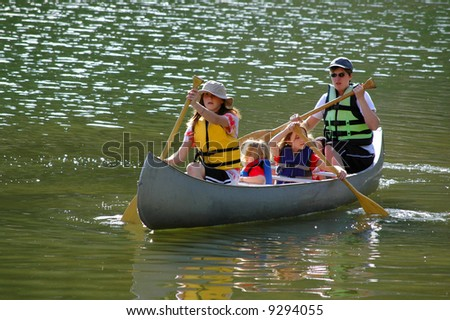 Family in a Canoe on a Lake