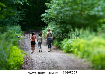 Family in a forest in Denmark (shot with tilt and shift) - stock photo