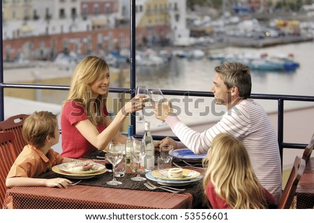 family in a sea restaurant