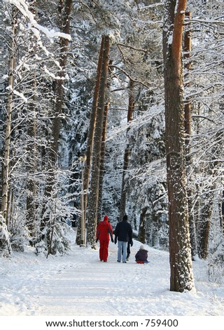 Family in a winter forest