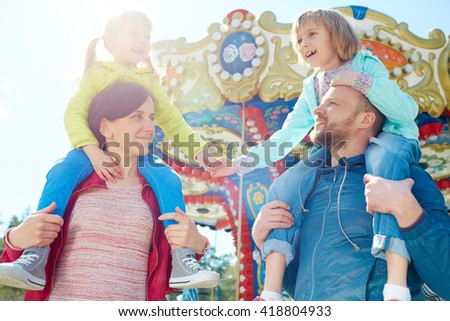 Family in amusement park