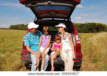 Family in car on vacation, happy parents and kids travel and have fun, car insurance concept
