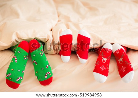 family in christmas socks lying ...