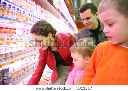 family in food shop