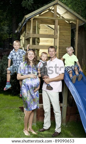 Family in front of children house