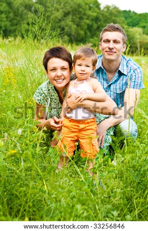 Family in grass