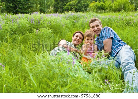 Family in green grass