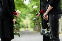 Family in guard of honor at funeral, only torso of people to be seen