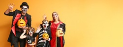 Family in Halloween costumes on color background with space for text