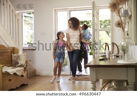 Family In Hallway Returning Home Together #496630447
