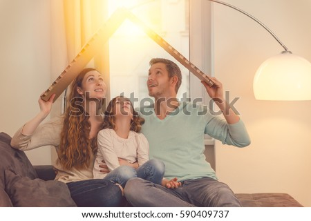 Shutterstock family in house planning with daughter