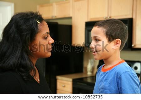 Family in kitchen talking