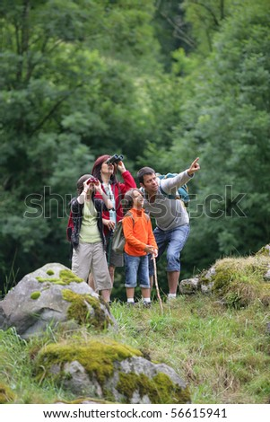 Family in the countryside looking through binoculars