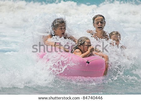 family in the waves