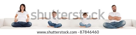 Family in white tshirts and denim jeans sitting on long white couch. Panorama format, isolated. - stock photo