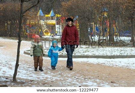 Family in winter city park  return home