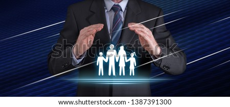 Family insurance concept with businessman in a protective gesture #1387391300