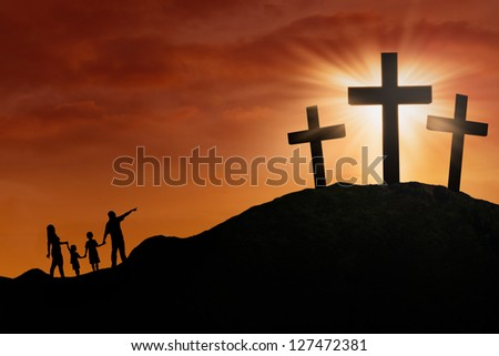 Family is walking toward the Cross on the hill under sunset background