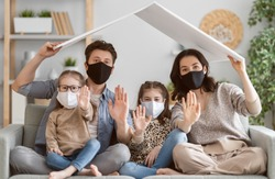 Family is wearing facemasks during coronavirus and flu outbreak. Virus and illness protection, quarantine. COVID-2019. A call to stay at home