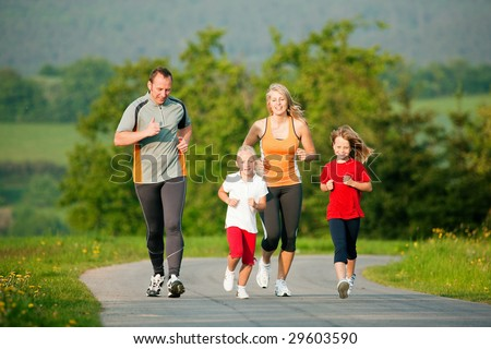 Family jogging outdoors with the kids