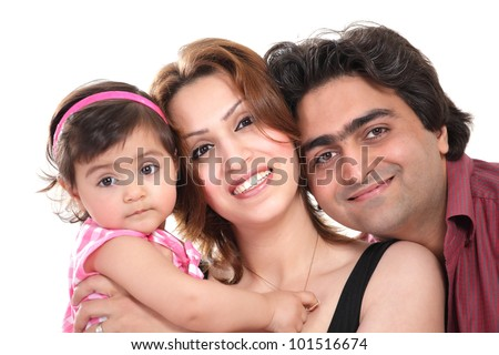 Family joy: happy smiling couple holding baby