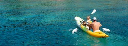 Family kayaking, father and son paddling in kayak on mediterranean sea canoe tour, having fun, outdoor activities with children in Greece
