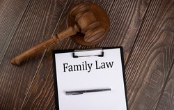 FAMILY LAW text on paper with gavel on the wooden background