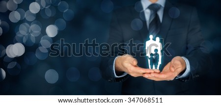 Family life insurance, family services, family policy and supporting families concepts. Businessman with protective gesture and silhouette of family. Wide banner composition with bokeh background.  #347068511