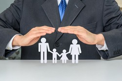 Family life insurance, financial security concept : Businessman protects family members e.g parents and two child, depicts protection from insurer, they will pay a lump sum for clearing burden of debt