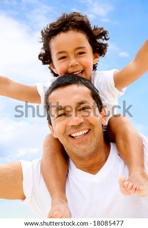 family lifestyle portrait of a dad with his son having fun outdoors