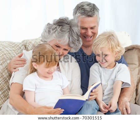 Family looking at a photo album in the living room