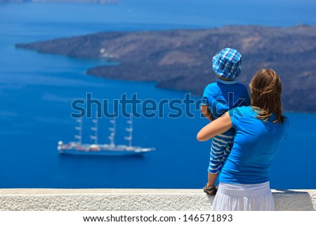 family looking at Santorini, Greece