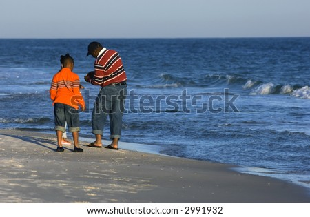 Family looking for clams on the beach of Gulf of Mexico