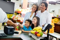 Family looking out for home finances at the supermarket