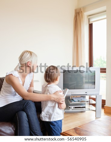 Family looking to the television in the living room