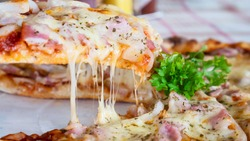 Family lunch eating pizza ham cheese recipe - people with favour italian dish concept