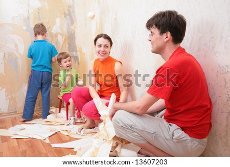 family makes interruption in  removal of  old of  wallpapers