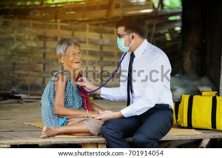Family medicine visits the  elderly woman in rural #701914054