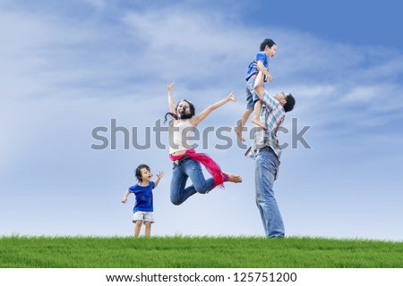 Family members including parents and two children are having fun at the park