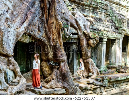 Family mother and daughter at ancient Preah Khan jungle temple in Angkor Archaeological area in Cambodia
