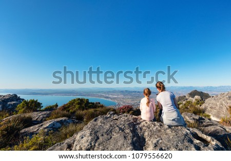 Family mother and daughter enjoying breathtaking views of Cape Town from top of Table mountain
