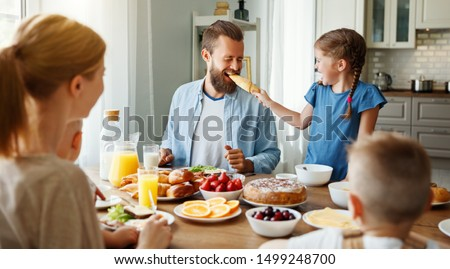 family mother father and children have Breakfast in the kitchen in morning