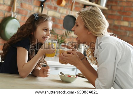 Family. Mother with daughter in kitchen #650864821